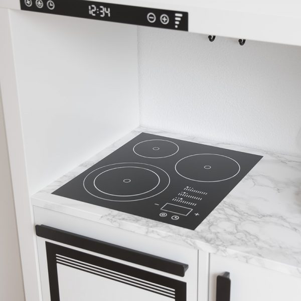 Cooktop with three heating elements on a Kallax shelf