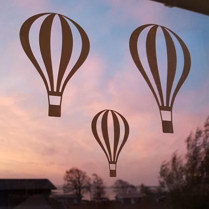 Luftballonger i soluppgång
